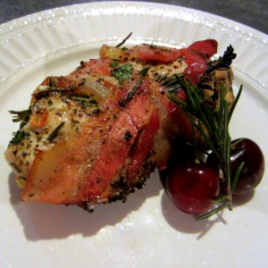 Organic Chicken Breast Stuffed w/ Spinach, Garlic, Peppers, Onion, Dusted w/ Earthy Seasoning, & Wrapped w/ Sprigs of Rosemary and Massive Cuts of Australian Bacon. To Side… Fresh Sweet Cherries.